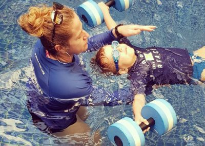 child learning back float